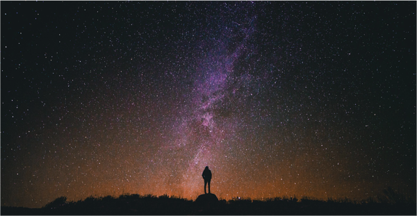 Man silhouetted against night sky