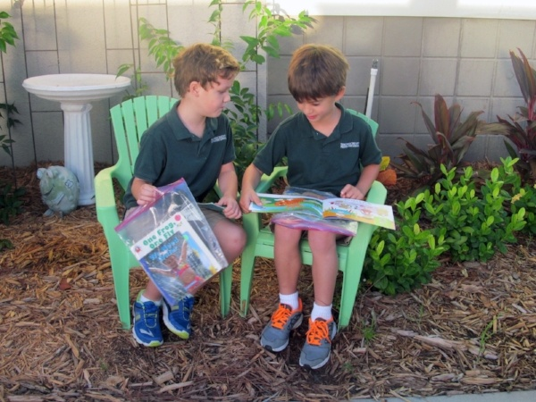 Important to read to children, kindergarten reads outside