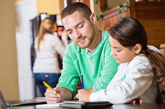 father helps student with homework